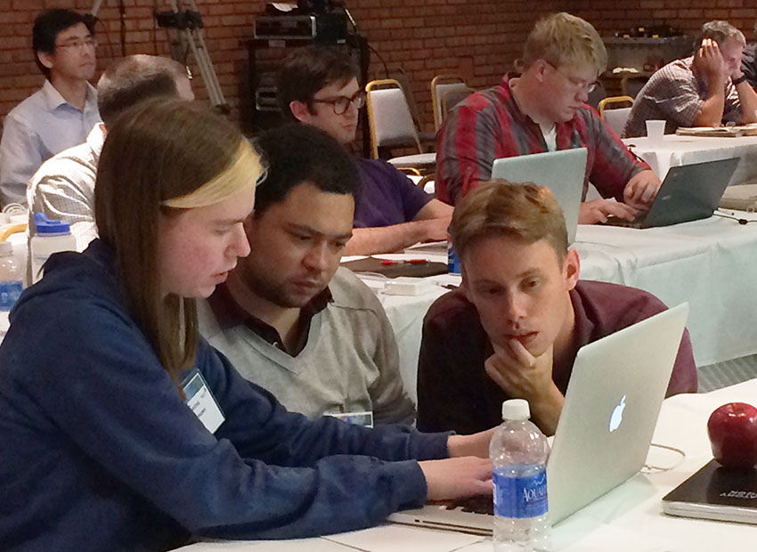 Attendees collaborate on hands-on exercises