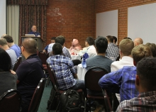 Paul Messina addresses attendees during a dinner session