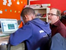 Argonne staff member helps a student